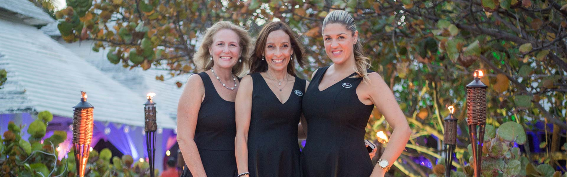 three ladies dressed in black